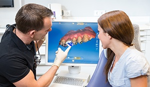 Dentist and patient looking at digital impressions