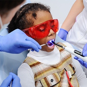 Child receiving dental sealants