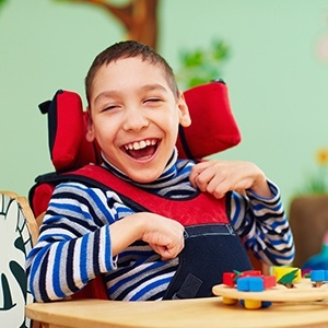 Laughing boy in wheelchair