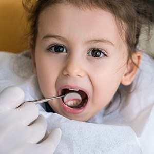 Small girl receiving dental exam