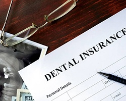 Insurance paperwork for the cost of dental implants in Alhambra