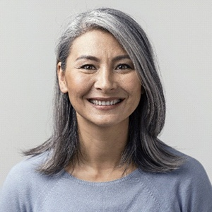 Smiling woman with dental implants in Alhambra