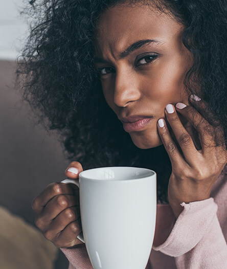 Woman in pain after drinking hot beverage