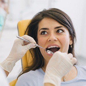 Woman receiving dental exam